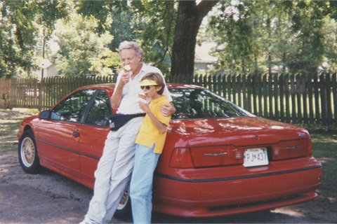 Michael and his son Andy in front of one of Michael's many cars, this one a 92 Ford Thunderbird.