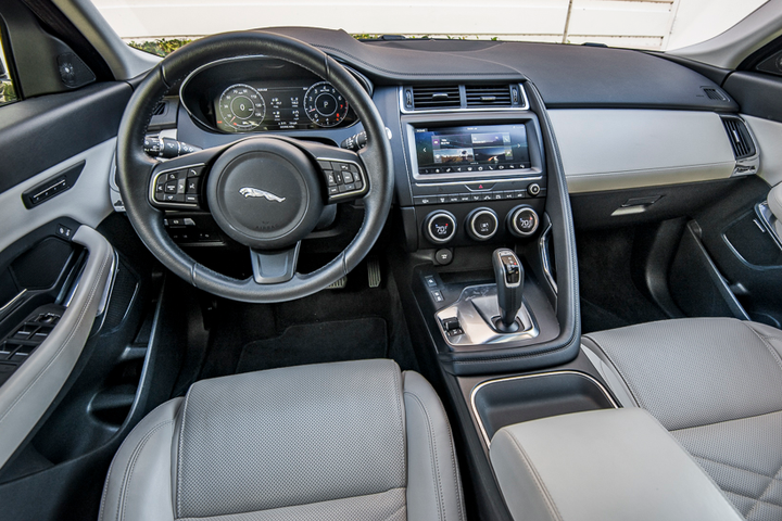 "The E-Pace interior uses sporty F-Type cues such as a wraparound cockpit and an elevated ""Sports Command"" driving position.