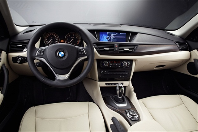 "BMW designed the exterior and interior to emphasize BMW X-model design cues and the X1's new ""sporting"" characteristics."