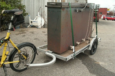 Bikes At Work uses a medium-sized trailer to transport this heavy duty oven across town for one of their customers.