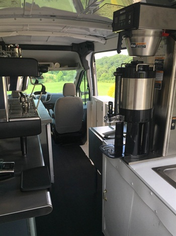 The Grateful Grail's customized coffee shop on wheels features an espresso machine, coffee machine, sinks, refrigerator and a kegerator for nitro cold brew.