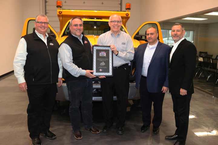 The truck was delivered at an event hosted at a Rush Enterprises-owned Custom Vehicle Solutions facility in Denton, Texas. Executives from Navistar, Inc., Rush Truck Centers, Team Fishel, and Godwin Manufacturing — who bodied the truck — attended the event.  - Photo courtesy of Navistar International Corp.
