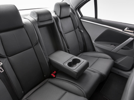 The sedan is a five-passenger EV, with backseat cupholders, front seatback storage pockets and...