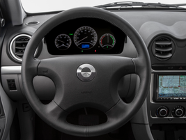 The vehicle's top speed is 85 mph. The dash also shows battery charge percentage and a real-time...