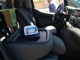 The passenger seat folds flat to act as a mobile desk. The center console also accommodates...