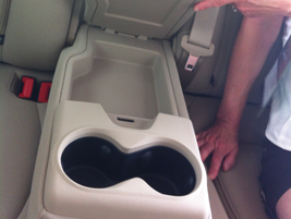 The Dodge Dart rear seat even has convenient storage options.
