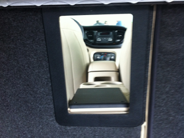 The pass-through opening from the Dodge Dart trunk allows long objects to be stowed.