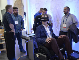 Attendees experience Ford's autonomous technology on the Transit Connect van usingvirtual...