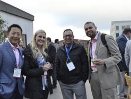 Jon Stanley and Kellie Jones of Bridgestone (left to right) enjoy the rooftop reception along...