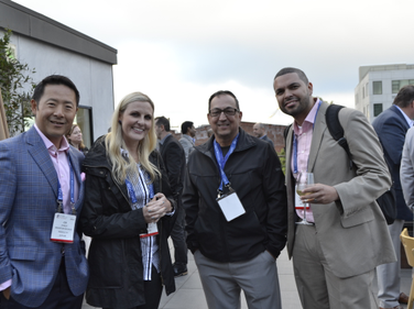 Jon Stanley and Kellie Jones of Bridgestone (left to right) enjoy the rooftop reception along...