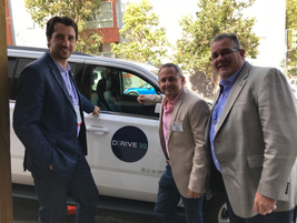 Marco della Torre (left) and Karl Weber of Derive Systems greetChris Brown of Bobit Business...