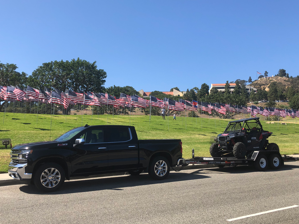 Attendees drove the 2019 Silverado, towing an ATV on a trailer, up the Pacific Coast Highway in...