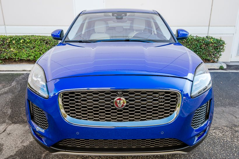 The E-Pace's exterior features Jaguar's signature grille, along with a teardrop design, steeply...