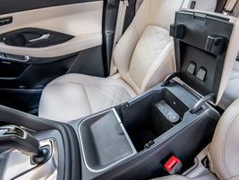 The 2.22-gallon center console compartment can house four large water bottles, as well as...