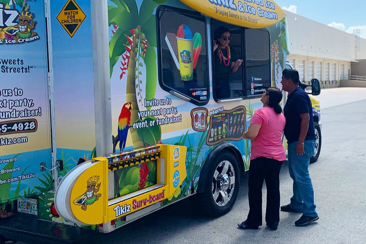 Wrapped in a Hawaiian beach theme, the custom-built Tikiz truck is decked out with traditional...