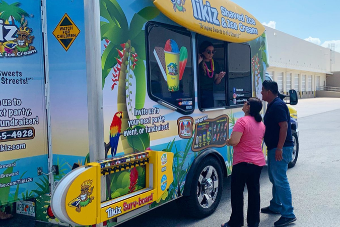Wrapped in a Hawaiian beach theme, the custom-builtTikiztruck is decked out with traditional...