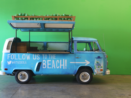Specialty vehicle makerCinema Vehicles decked out two 1973 VW buseswith a beach vibe for Vita...