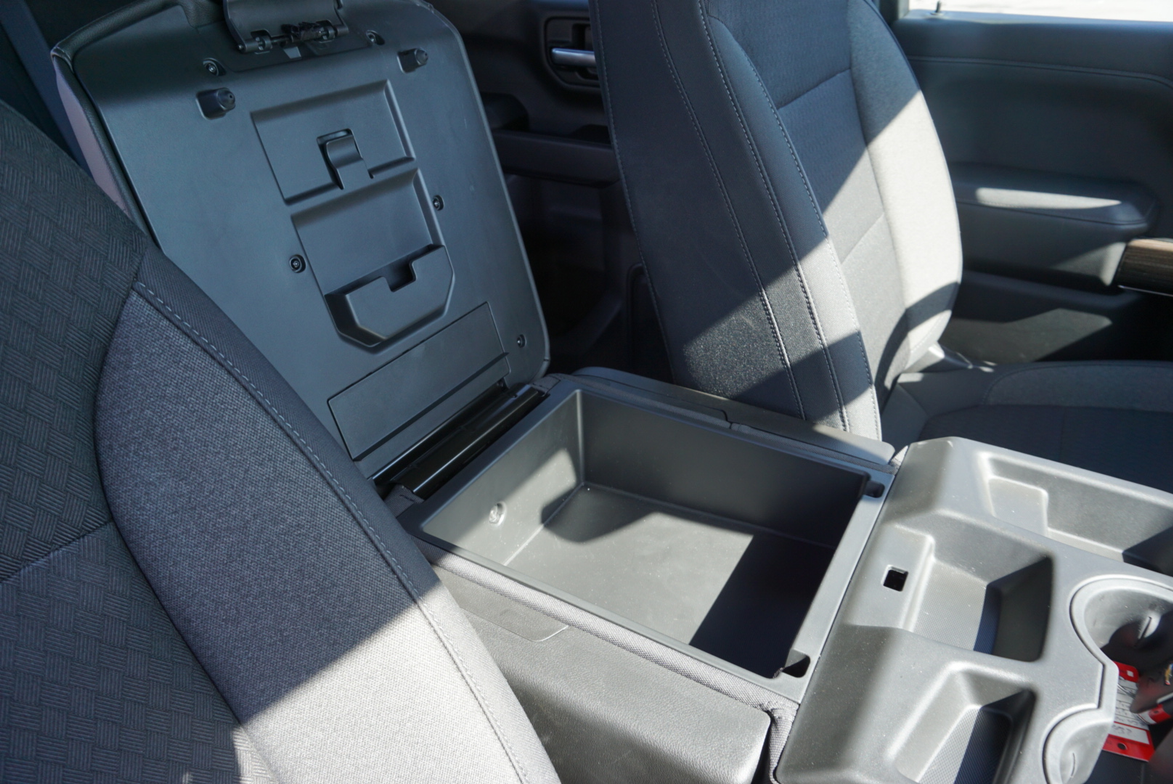 The interior of the Chevrolet Silverado 1500 includes a spacious center console.