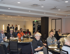 Atteneed of the Los Angeles stop of Roush's California Roadshow listen as Chelsea Jenkins,...