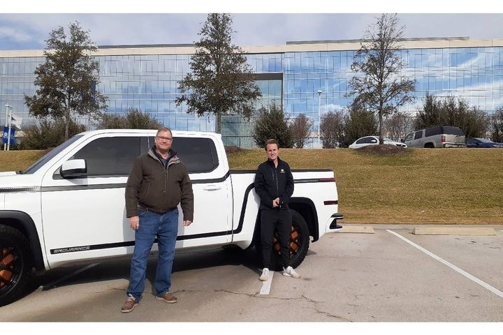 E Squared CEO Tim Grosse (L) with Lordstown sales rep Luke Tatman,with a Lordstown Endurance electric pickup truck. E Squared has formed one of its closest partnerships with Lordstown Motors, whose all new, all-electric Endurance 4WD pickup it hosted at its headquarters in Frisco, Texas, outside Dallas. - Photo: E Squared Energy Advisors