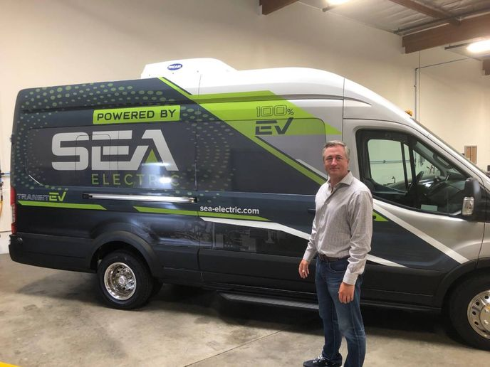 SEA Electric President of the Americas Mike Menyhart with a modified Ford Transit van that helps promote the company's battery-based power drive systems that can be adapted to and assembled within a variety of truck sizes and weights. - Photo: Martin Romjue / Charged Fleet