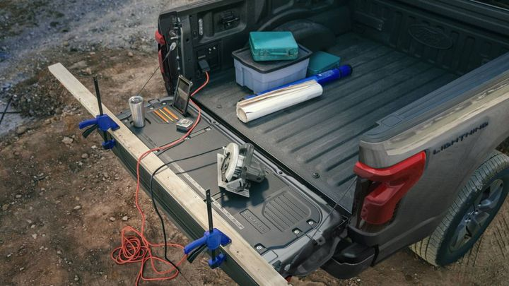 Designed with bumper-height clearance, this water-resistant space comes equipped with four electrical outlets, two USB chargers and a drainable floor that can double as a food and beverage container. It can easily power a mobile work site or an epic tailgate. - Photo: Ford