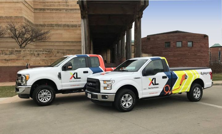 XL's achievement highlights its recent growth and growth path for years to come as it continues to electrify the commercial fleet industry. Pictured are two XL Fleet F-series pickup trucks. - File photo: XL Fleet