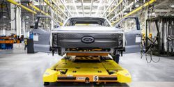 The first pre-production F-150 Lightning pickup trucks roll out of Ford's new Rouge Electric Vehicle Center.