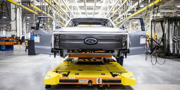 The first pre-production F-150 Lightning pickup trucks roll out of Ford's new Rouge Electric...
