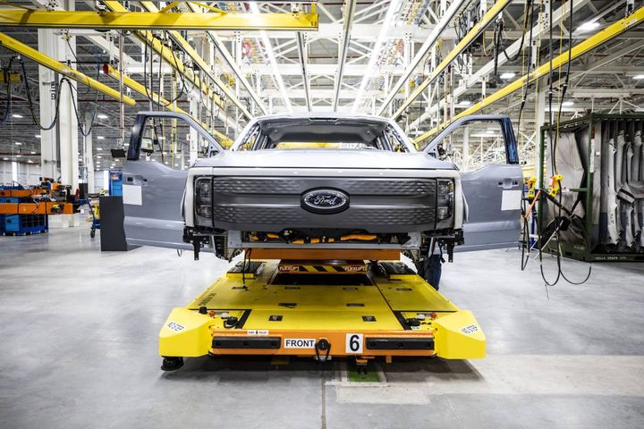 The first pre-production F-150 Lightning pickup trucks roll out of Ford's new Rouge Electric Vehicle Center. - Photo: Ford Motor Co.