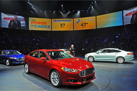 Derrick Kuzak, Group Vice President, Global Product Development, Ford Motor Company speaks with journalists from around the world at the North American International Auto Show. Ford today introduced its new 2013 Ford Fusion, center, 2013 Ford Fusion Hybrid, left, and 2013 Fusion Energi, right.