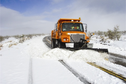 Among the various types of weather the County experiences is snow. Here, a dump truck is used for snow plowing.