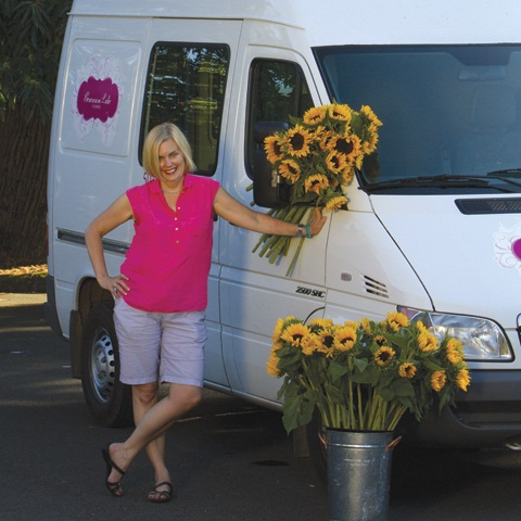 Photo by AlanWeinerPhotography.comKim Foren is able to fit six-foot-tall floral arrangements in her Sprinter, which runs on biodiesel. She says her young drivers handle the van just fine.