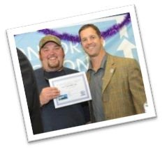 Harbaugh congratulates the winner of the Royal Caribbean Cruise: Jay Tribull of Beach Bound Auto Sales.