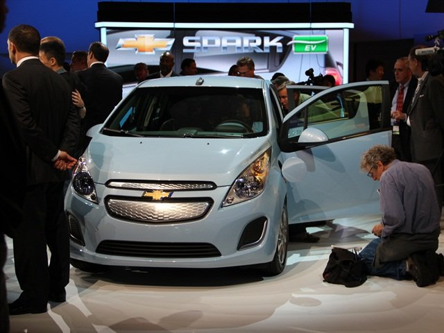 A crowd checks out the Spark EV at the LA Auto Show.