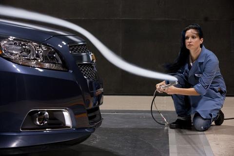 Chevrolet Malibu aerodynamic engineer Suzy Cody tests the 2013 Malibu ECO with a smoke wand at the General Motors wind tunnel Friday, June 24, 2011 in Warren, Michigan.