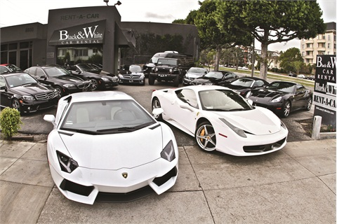 Black and White's fleet of luxury and exotic rentals makes a statement on the lot. Sam Zaman says 90% of his fleet is either black or white, his favorite colors for vehicles.