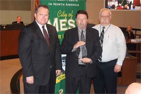 (L-R) City of Mesa Mayor Scott Smith stands with Jim Wright, associate director of the Government Fleet Management Alliance (GFMA) and Peter Scarafiotti, director & automotive engineer, Fleet Services Department, City of Mesa. Wright presented the crystal award to Fleet Services for attaining the CFMO certification.