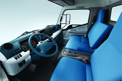 The FE/FG Series was specifically designed to provide a car-like interior. The passenger seats can fold down to form a work area for the driver, and extra storage compartments have been added in the cab area.