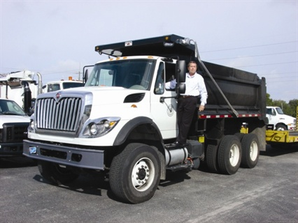 Greg Morris, fleet manager for Sarasota County, Fla., showed his new fleet services dump truck to event attendees.