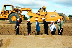 """<p><span style=""""font-size: xx-small;"""" mce_style=""""font-size: xx-small;""""><span lang=""""EN""""> <p dir=""""ltr"""" align=""""left"""">Three employees were selected to help break ground along with Eden Prairie Mayor Nancy Tyra-Lukens (left), Deb Frodl, chief strategy officer for GE Capital Fleet Services and global EV leader for GE (second from left),and Clarence Nunn, president and CEO of GE Capital Fleet Services (fourth from left). An architectual rendering (above) shows what fleet managers can expect of the experience center.</p> </span></span></p>"""