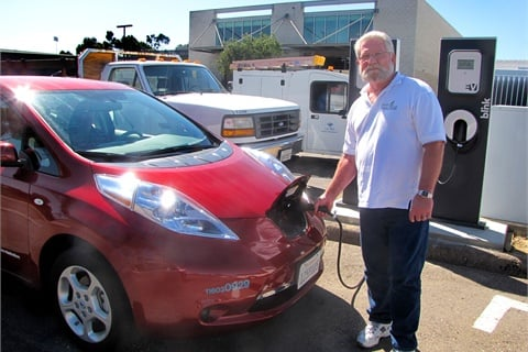 "Jim Ruby of the University of California, San Diego charges one of the school's five Nissan Leafs, acquired as part of the university's ""Tailpipe Endgame"" sustainability initiative."