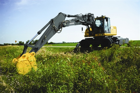 The John Deere 220D W wheeled excavator allows operators to drive to a jobsite rather than loading the equipment onto a trailer.