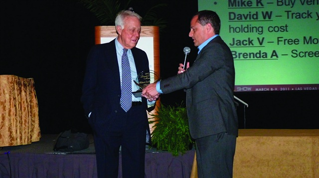 At the 2011 Car Rental Show, Chris Brown of Auto Rental News presents LaPlaca with the Russell Bruno Award for outstanding service to the car rental industry.