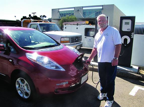 "Jim Ruby, facilities management fleet director for the University of California, San Diego, charges one of the school's five Nissan LEAFs, acquired as part of the University's ""Tailpipe Endgame"" sustainability initiative."