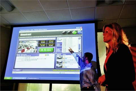 Technological advances have helped transform auto auctions. Automotive Resources International's Brian McBrearty and Jennifer Schade provide a live demonstration of the company's Remote Rep technology.