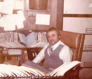 Superior Distributors Founder Howard Klein sits in his office in the 1970s. Below, Klein with his granddaughter Dana Klein, chief information officer, and son Rick Klein, vice president.