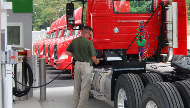 Talon Logistics' Volvo VNM daycabs use dual frame-mounted CNG tanks, rather than the back-of-cab cabinet frequently seen.