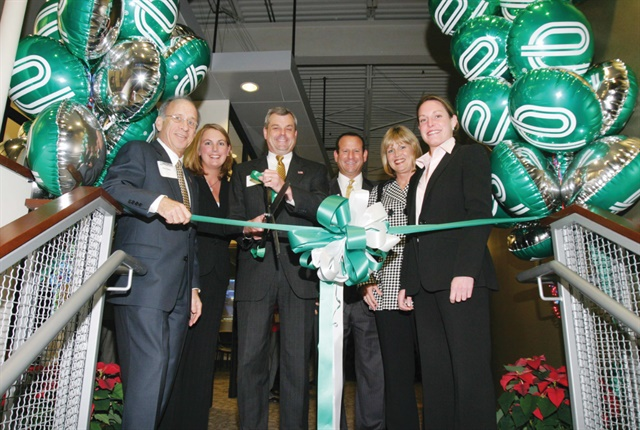 (L to R) Don Ross, Carolyn Kindle Betz, Bob Schurwan, Steve Bloom, Pam Nicholson, and Christine Taylor celebrate the opening of the former Fleet Operations facility in 2004. Photo: Enterprise Fleet Management
