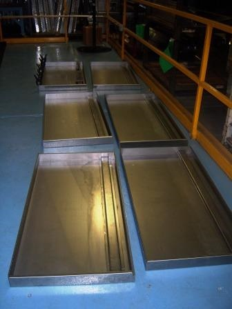 Truck Toolbox lids, bonded with adhesives, are ready for powder coat processing.(Photo courtesy of LORD Corp.)